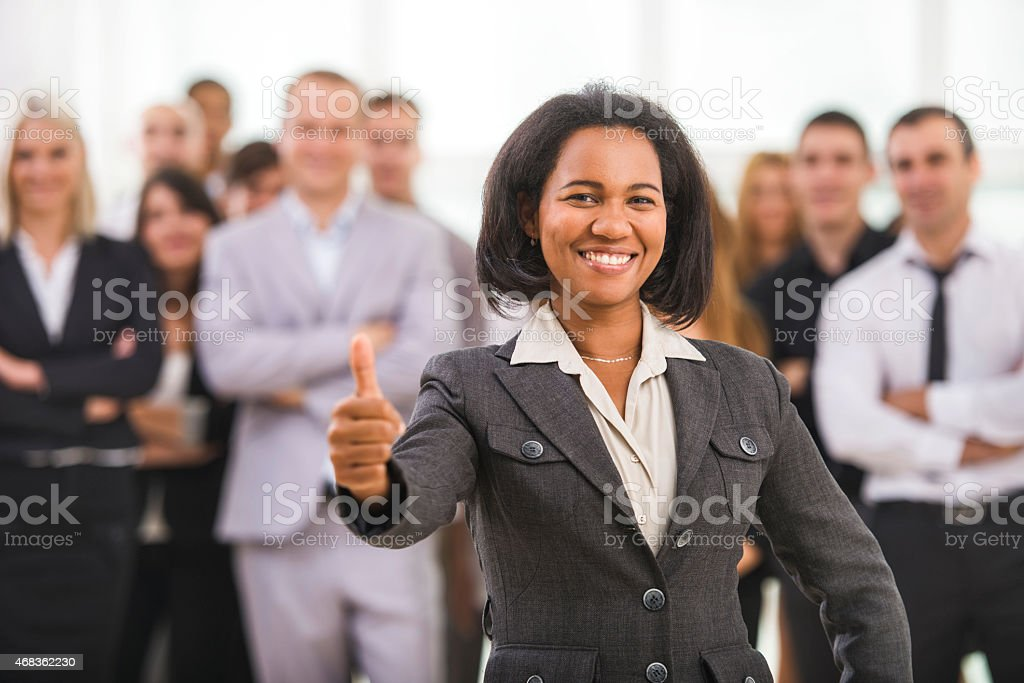 Smiling African American businesswoman showing thumb up. royalty-free stock photo