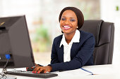 istock Smiling African American businesswoman using a computer 177774210