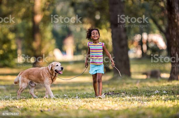 Smiling african american girl walking her dog on a leash picture id629076332?b=1&k=6&m=629076332&s=612x612&h=ogsurwkjfzvsumbmmajkxkftwjoa7nszu6tddtcz3bm=