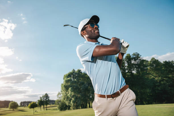 smiling african american man in cap and sunglasses playing golf - golf stock pictures, royalty-free photos & images