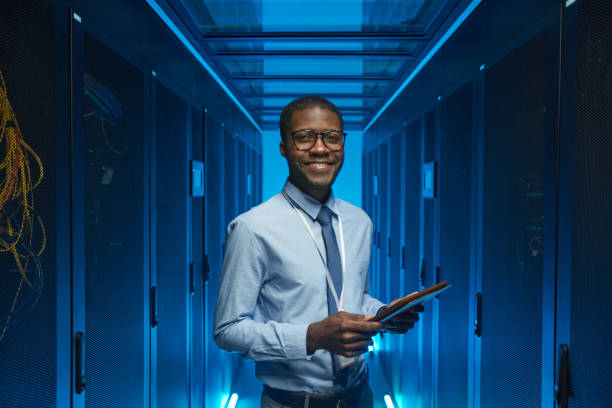 Smiling African American Man in Data Center stock photo