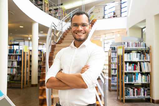 istock Smiling African American man posing at public library 1177172333