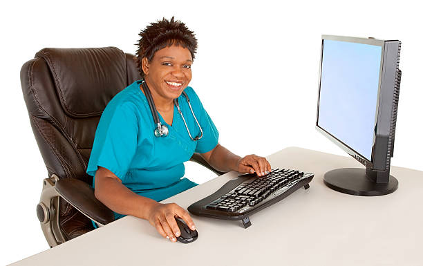 Smiling African American Nurse Looking at Camera While Sitting a stock photo