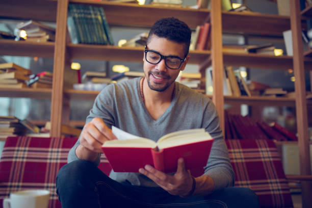 Smiling african american student enjoying book reading in library picture id846661944?b=1&k=6&m=846661944&s=612x612&w=0&h= aljmyxovn2 ew6rvzigskwl 2uyvd5ec5z1aflpmtu=