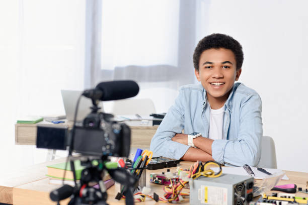 smiling african american teenager shooting video blog at home - vlogger stock photos and pictures
