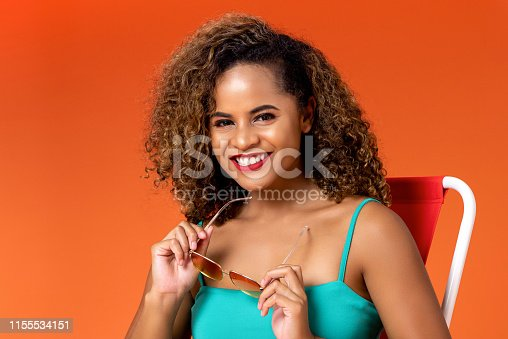 istock Smiling African American woman in summer casual clothes 1155534151