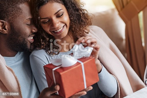 istock Smiling African American woman receiving congratulations from her boyfriend 637193888