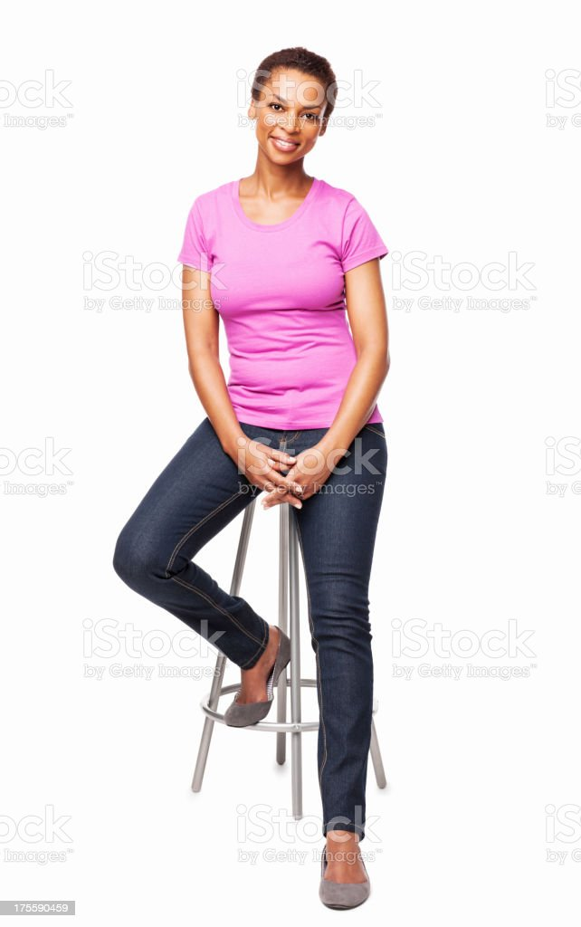 Smiling African American Woman Sitting On Chair - Isolated stock photo
