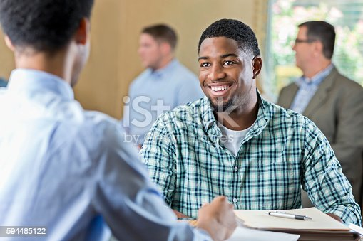 istock Smiling African American young adult at a job interview 594485122