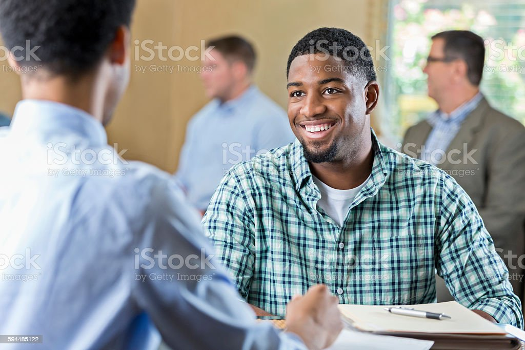 Smiling African American young adult at a job interview – Foto
