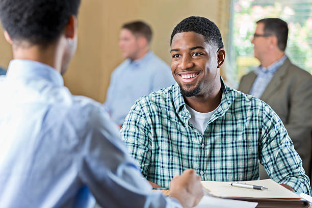 Smiling African American young adult at a job interview stock photo