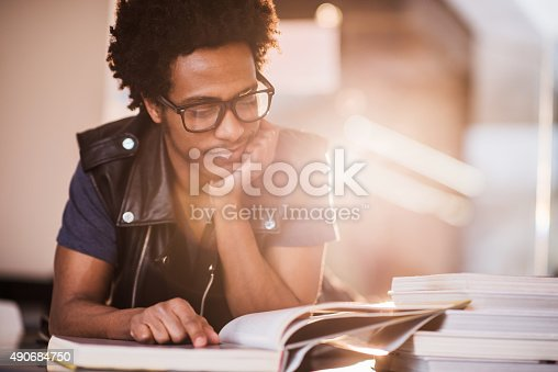 istock Smiling African American young man studying. 490684750