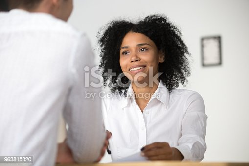 istock Smiling african hr interviewing job applicant, human resources management concept 963815320