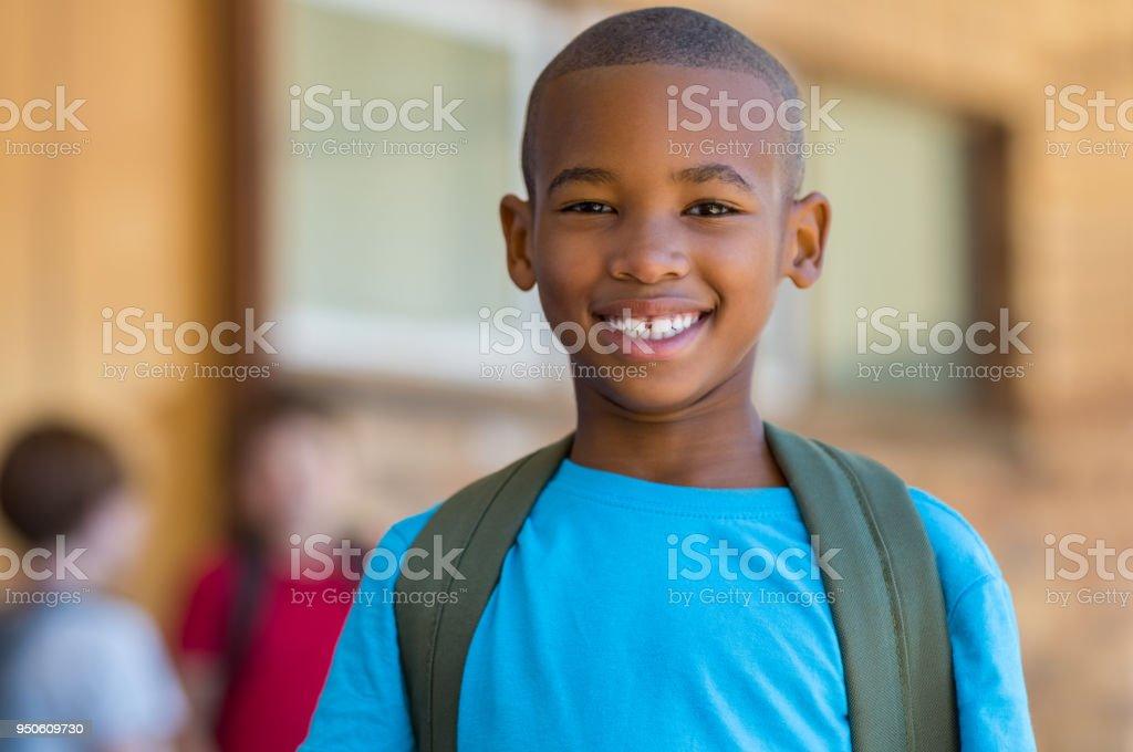 Smiling african school boy stock photo