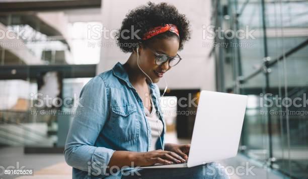 Smiling african student studying for an exam on campus picture id891625526?b=1&k=6&m=891625526&s=612x612&h=59nysxcv3csttu4yyhab0lyfcbaul94wr9el7q6j 9g=