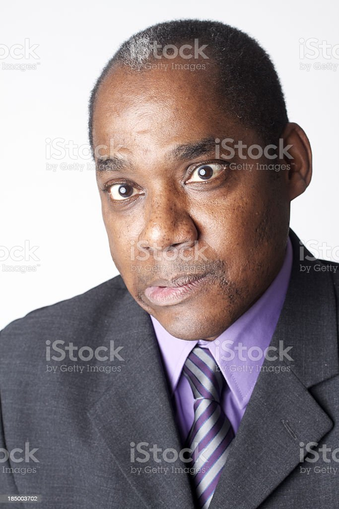 Smiling African-American businessman with a funny face royalty-free stock photo
