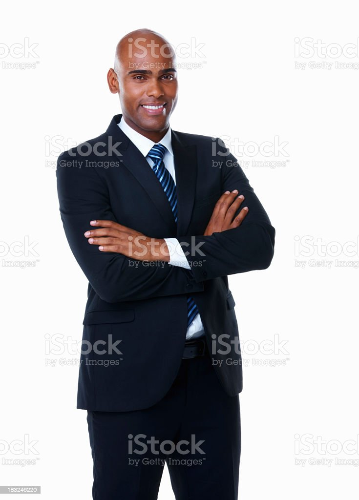 Smiling African-American businessman with arms folded stock photo