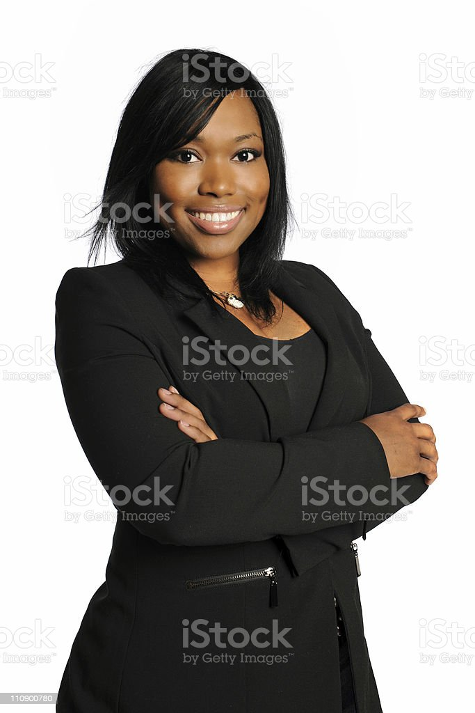 Smiling African-American businesswoman with arms crossed royalty-free stock photo