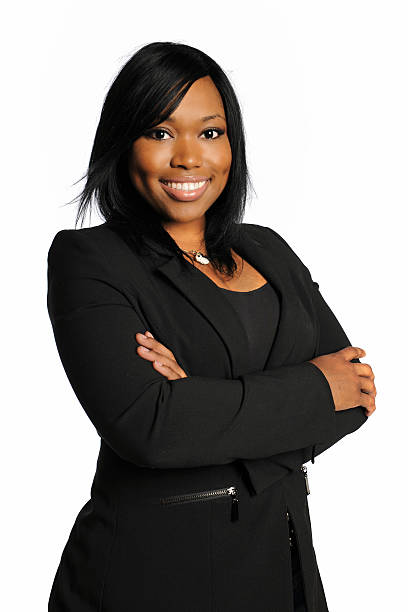 Smiling African-American businesswoman with arms crossed stock photo