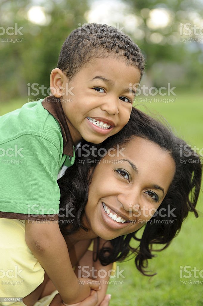 Smiling African-American mother and son stock photo