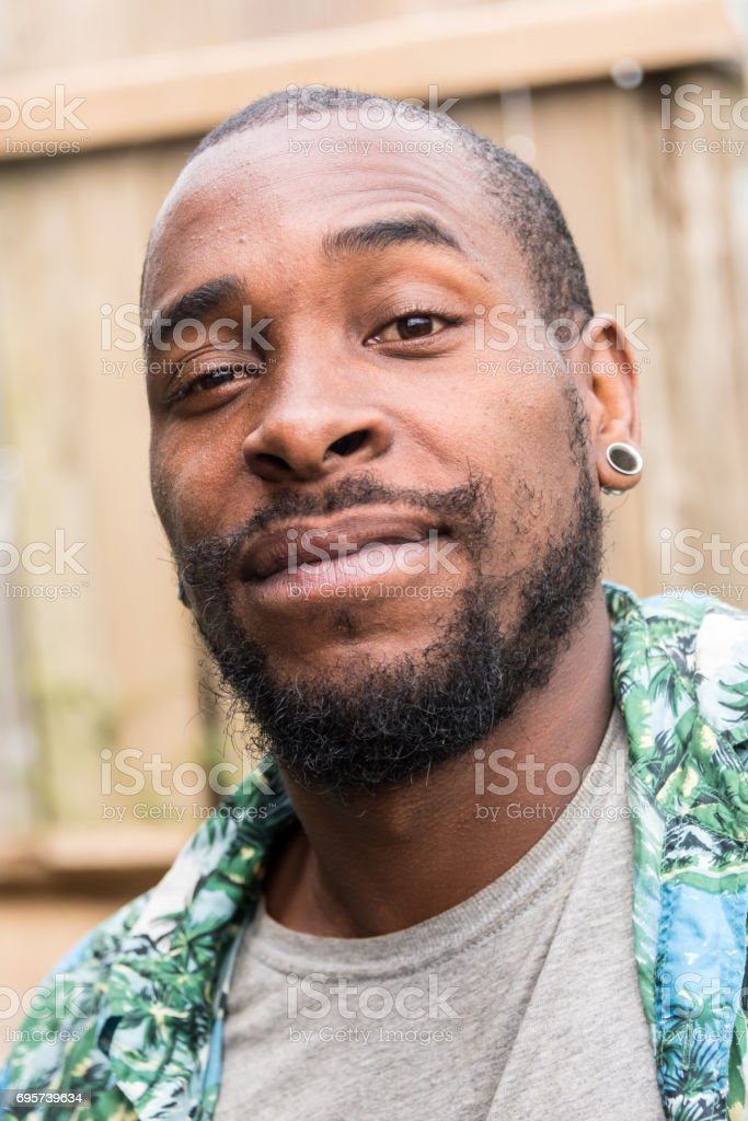 Smiling afro caribbean man stock photo
