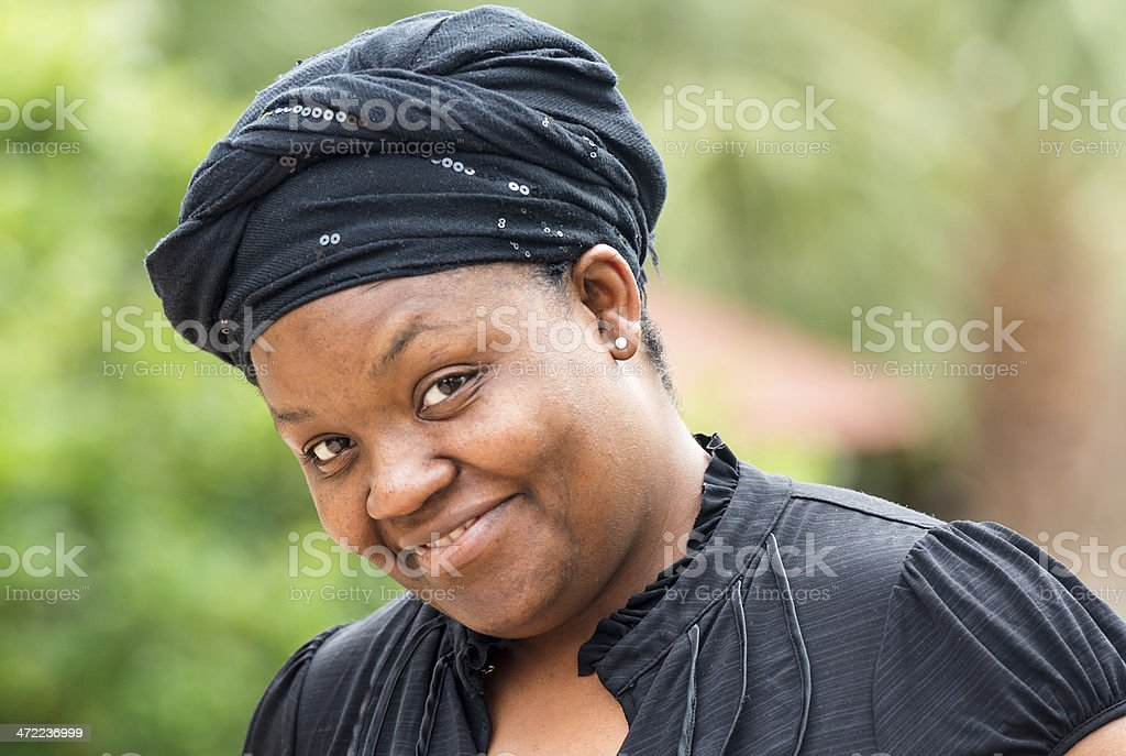 Smiling Afro Caribbean woman wearing headscarf stock photo