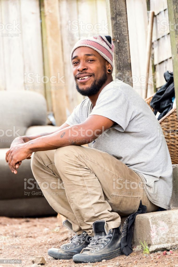 Smiling afro caribbean young man stock photo