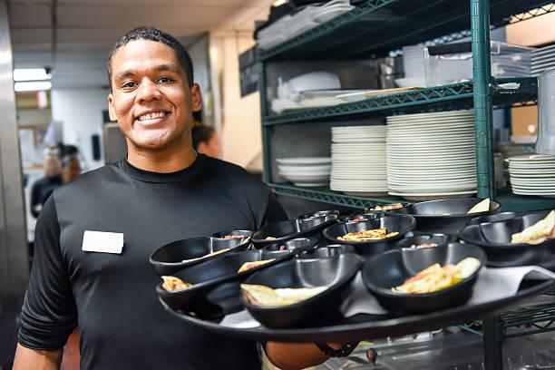 Smiling afro-caribbean waiter - Photo