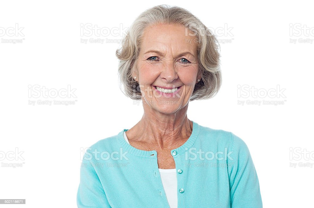 Smiling aged lady in casuals stock photo