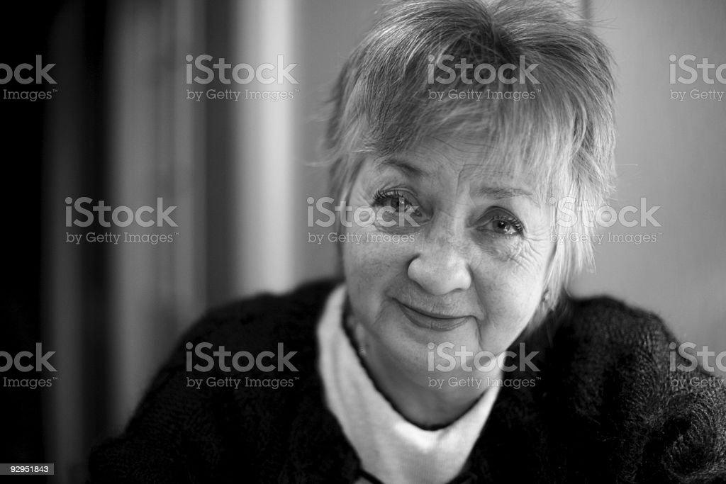 smiling aged woman portrait stock photo