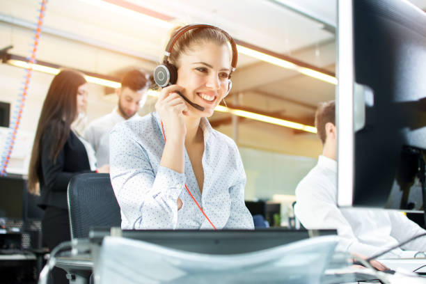 smiling agent woman with headsets. portrait of call center worker at office. - call centre stock pictures, royalty-free photos & images