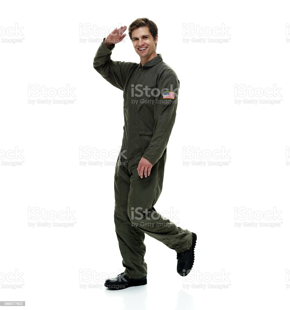Smiling air force saluting stock photo