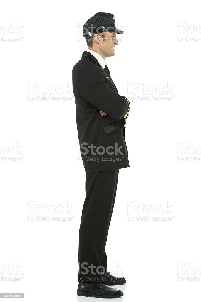 Smiling airlines pilot standing with arms crossed royalty-free stock photo
