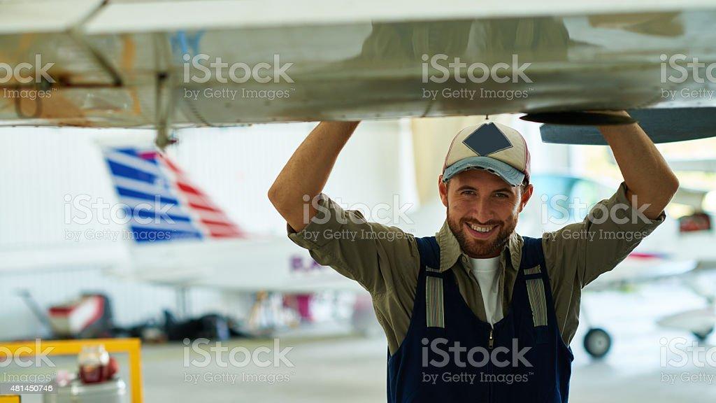 Smiling airplane engineer stock photo