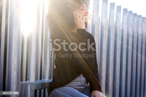istock Smiling american female traveler having mobile conversation with friends using connection of international operator in roaming while enjoying spending leisure time in good sunny weather outdoors 904257588