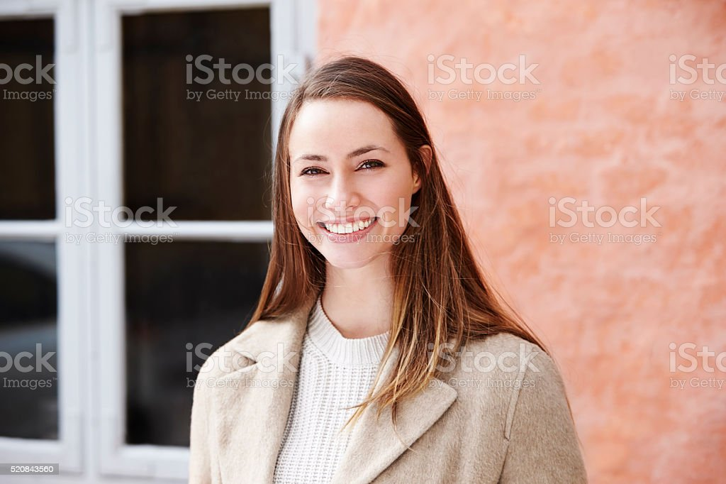 Smiling and beautiful young woman, portrait stock photo