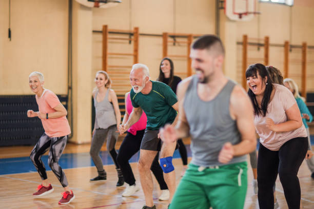 Smiling and happy group of people dancing at gym Smiling and happy group of people dancing at gym community health stock pictures, royalty-free photos & images