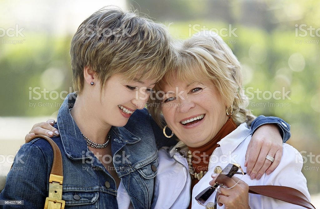 A smiling and happy mother and daughter royalty-free stock photo