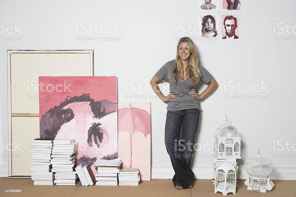 smiling and leaning against wall royalty-free stock photo