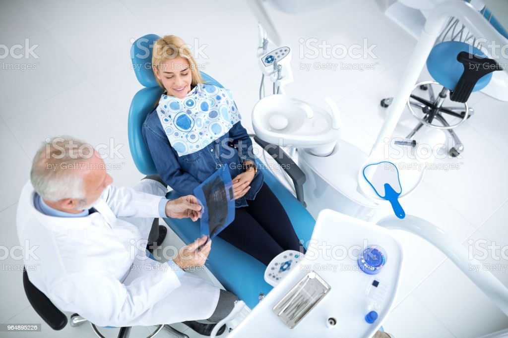 Smiling and satisfied patient after successful treatment with her teeth royalty-free stock photo
