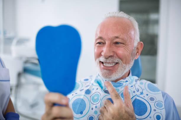 smiling and satisfied patient after treatment - dentist zdjęcia i obrazy z banku zdjęć