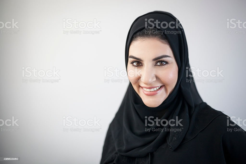 Smiling Arab Woman with Light Grey Vignetted Background stock photo