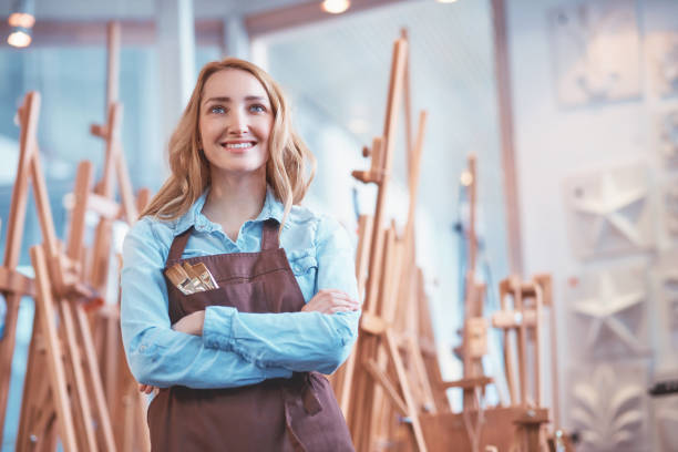 Smiling artist at easels stock photo