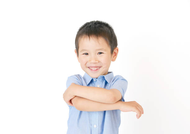 アジアの少年の笑顔 - 子供時代 ストックフォトと画像