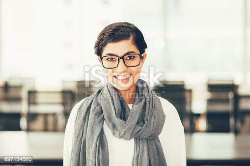 1003539592istockphoto Smiling Asian Business Lady in Conference Room 697134520