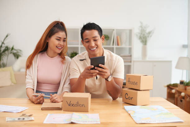 Smiling Asian Couple Planning Finances stock photo