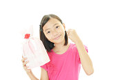 アジアの少女の笑顔をプレゼント