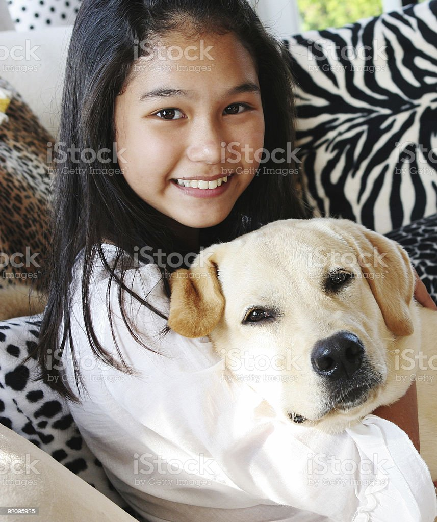Smiling Asian girl with her pet dog royalty-free stock photo