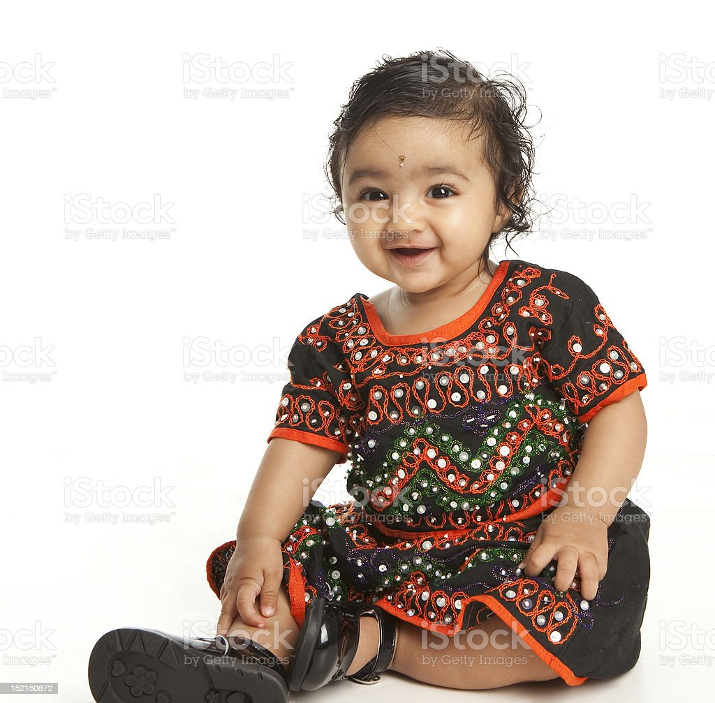 Smiling Asian Indian Baby Girl in Traditional Attire on White stock photo