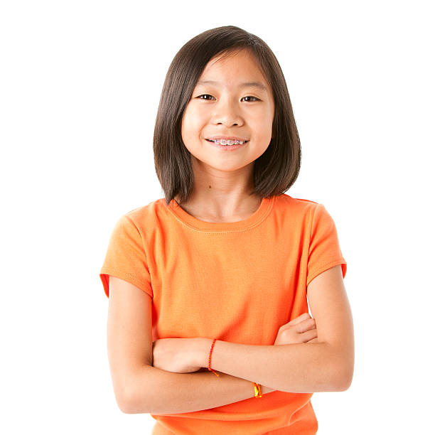Smiling Asian Little Girl A pretty nine-year old Asian girl shows off her braces with a big smile 8 9 years stock pictures, royalty-free photos & images